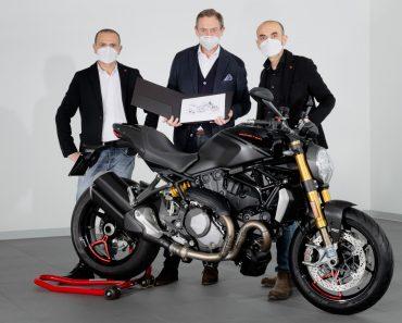 Ducati CEO Claudio Domenicali with Ducati Design Centre Director Andrea Ferraresi delivering the bike